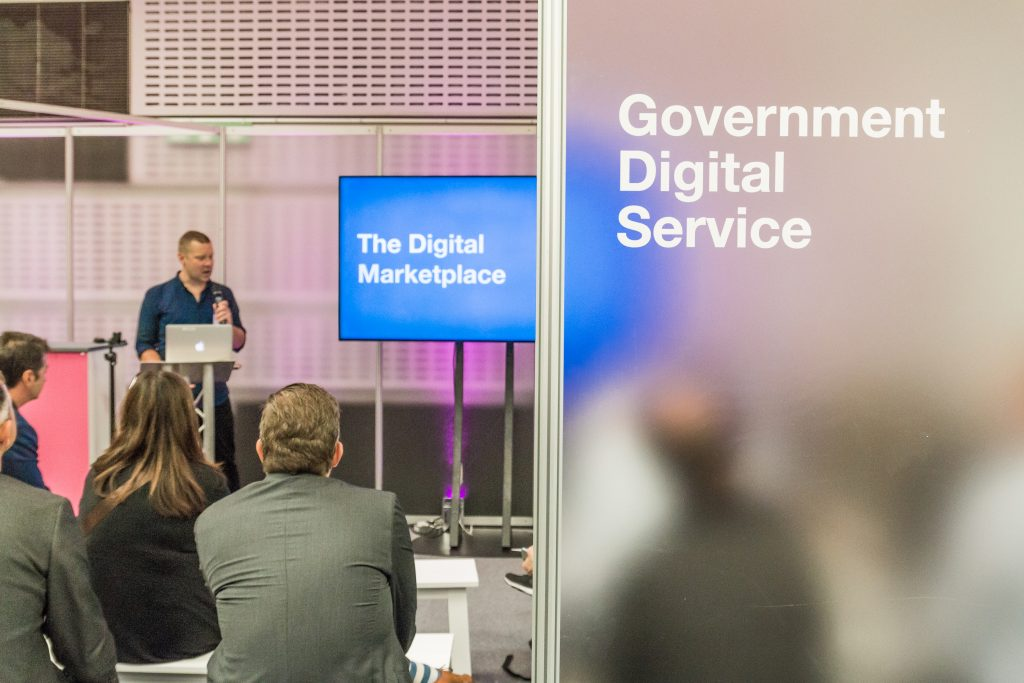 A GDS member of staff talking to an audience at a Digital Marketplace event
